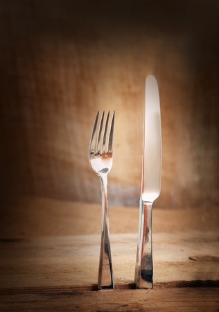 Restaurant menu series  Country place setting  Fork and knife in rustic country table setting  photo