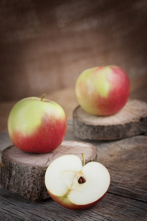 Fresh organic apple on wooden background photo