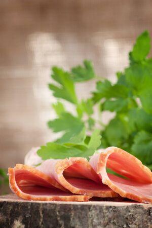 Fresh pork ham with garnish on wooden background photo