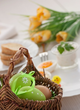 Traditional Easter breakfast. Table setting with Boiled eggs with ham, cottage cheese and Easter decorations