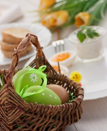 Traditional Easter breakfast. Table setting with Boiled eggs with ham, cottage cheese and Easter decorations Stock Photo - 12440849