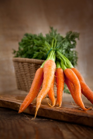 Fresh ingredients for cooking in rustic setting  carrot photo