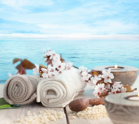 Spa and wellness setting with natural soap, candles and towel  Beige dayspa nature set