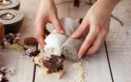 natural therapy: Spa and wellness manicure setting with natural soap, candles and towel  Beige dayspa nature set