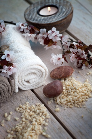 dayspa: Spa and wellness setting with natural soap, candles and towel. Beige dayspa nature set Stock Photo