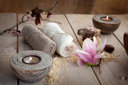 spa candles: Spa and wellness setting with natural soap, candles and towel. Beige dayspa nature set Stock Photo