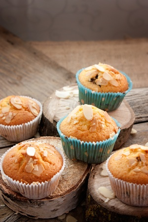 Delicious organic muffins. Almond and cherry cup cakes in natural setting. photo