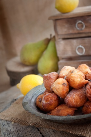Bowl of Deep fried fritters donuts in rustic country setting photo