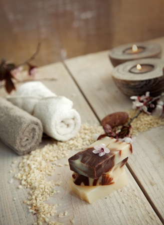 dayspa: Spa and wellness setting with natural soap, candles and towel  Beige dayspa nature set