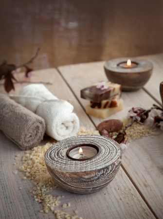 Spa and wellness setting with natural soap, candles and towel  Beige dayspa nature set photo