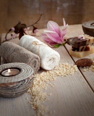 natural setting: Spa and wellness setting with natural soap, candles and towel. Beige dayspa nature set Stock Photo