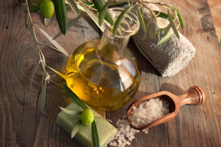 cosmetics products: Natural spa setting with olive and olive oil products  bath salt, natural soap and olive oil  Stock Photo