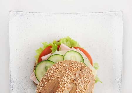 Delicious ham, cheese and salami sandwich with vegetables, lettuce, cherry tomatoes Stock Photo - 13712336