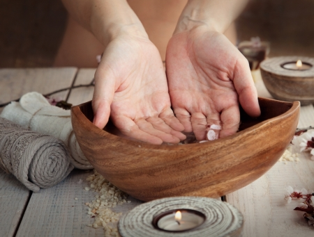 Spa and wellness manicure setting with natural soap, candles and towel  Beige dayspa nature set photo
