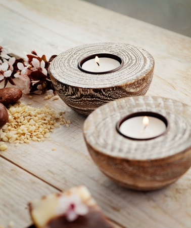 natural soap: Spa and wellness setting with natural soap, candles and towel. Beige dayspa nature set Stock Photo