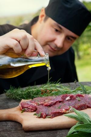 marinade: Cooking ingredients  marinated meat,oil,vinegar, herbs and vegetables