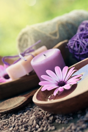 Spa and wellness setting with natural soap, candles and towel  Violet dayspa nature set dayspa nature set