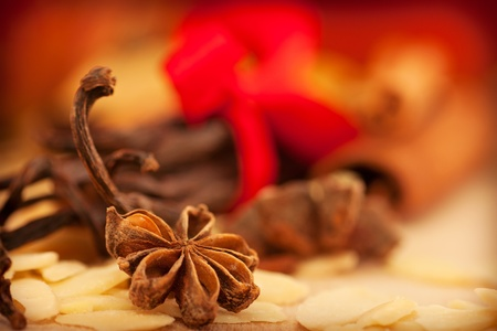 anice: Star anise and peeled almonds with cinnamon in the back  Stock Photo