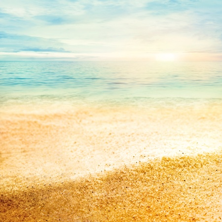 Beach summer background  with fine golden sand, sunset, sea and copyspace photo