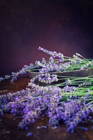 Fresh lavender over wooden background. Summer floral background with lavender flowers and wood. photo