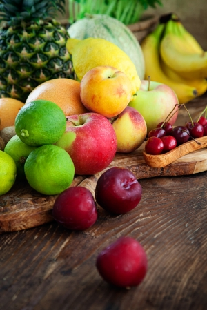 Organic Fruit variety on wood. Tropical exotic food concept. photo