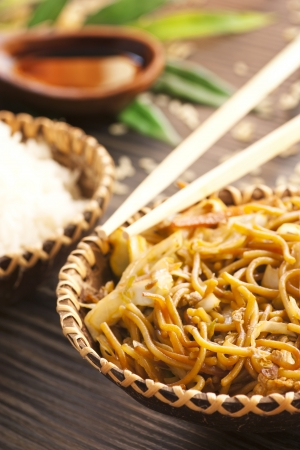 chinese noodle: Chinese food. Egg noodles with chicken and vegetables, steamed rice and soy sauce.