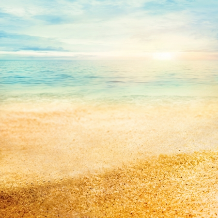 sand beach: Beach summer background  with fine golden sand, sunset, sea and copyspace Stock Photo
