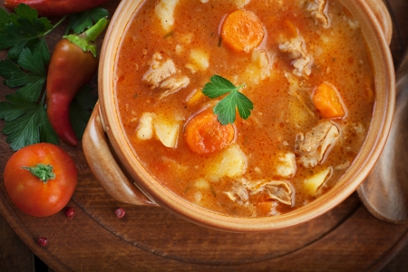 Delicious veal stew soup with meat and vegetables on wood