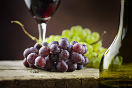 Wine concept. Food and drink background with red wine, fresh grapes and wine bottle Stock Photo - 15283421