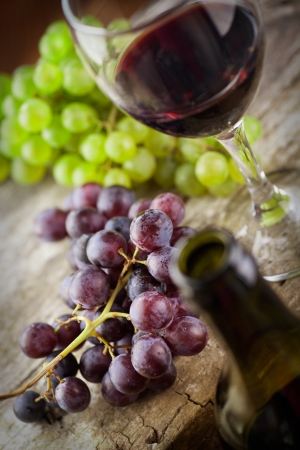 Wine concept. Food and drink background with red wine, fresh grapes and wine bottle Stock Photo - 15283424