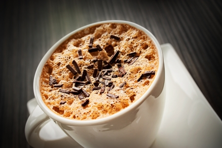 Coffee Cappuccino in white cup with chocolate sprinkles photo