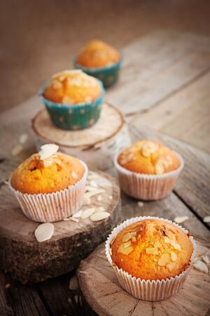 white backing: Delicious organic muffins. Almond and cherry cup cakes in natural setting. Stock Photo