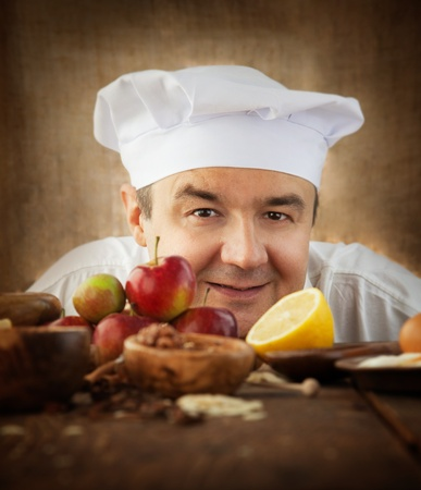 Baking concept background. Baker with ingredients for pastry desserts. Apples, lemon, sugar, walnuts Stock Photo - 15693471