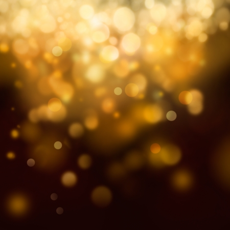 bokeh: Gold Festive Christmas background. Elegant abstract background with bokeh defocused lights and stars
