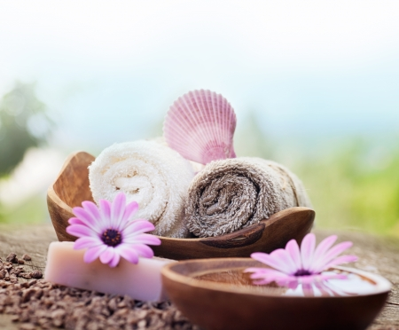 natural soap: Spa and wellness setting with natural soap, candles and towel. Violet dayspa nature set dayspa nature set Stock Photo