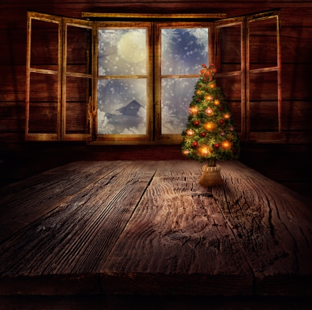 winter window: Christmas design - Christmas tree. Xmas winter background in wooden cabin with Christmas tree and window with winter night in the background. Stock Photo