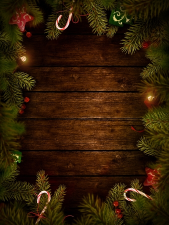 Christmas design - Merry Christmas. Xmas border card with with copyspace on wooden background. Christmas ornaments on wood with candy and ribbons. Stock Photo - 16678165