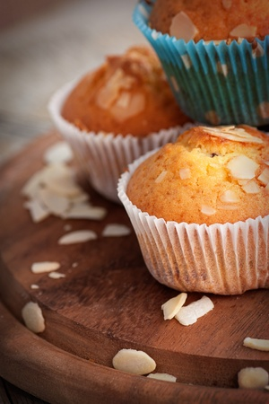 white backing: Delicious organic muffins  Almond and cherry cup cakes in natural setting