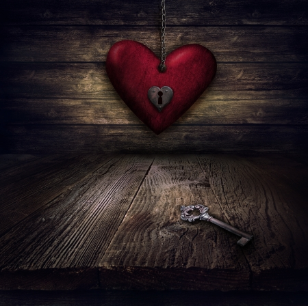 antique keyhole: Valentines design - Locked Heart in chains. Love concept Illustration with heart hanging on chains with keyhole and vintahe key on wooden background.