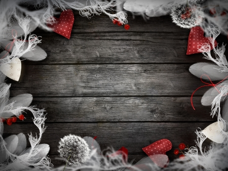 Valentines design - Love wreath with copyspace on wooden background  Valentines ornaments on wood with hearts and ribbons  Stock Photo - 17575705
