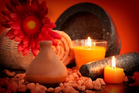Spa setting in orange tones with candles  Natural organic soap photo