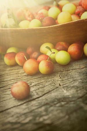 beam of light: Fruit garden concept  Freshly harvested sweet cherry on old wooden background with sunlight