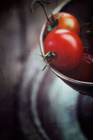 old fashioned vegetables: Cherry tomatoes  Vintage vegetables background with tomatoes in grunge style Stock Photo
