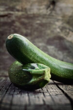 Vegetables background  Fresh green zucchini  on wood in vintage setting Stock Photo - 18167631