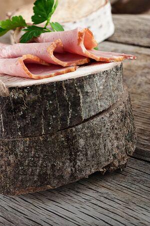 cured ham: Fresh pork ham with garnish on wooden background
