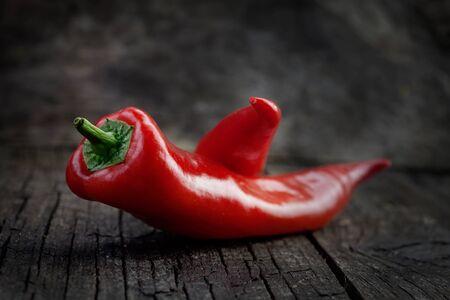 flavorings: Vegetables background. Fresh red pepper paprika on wood in vintage setting