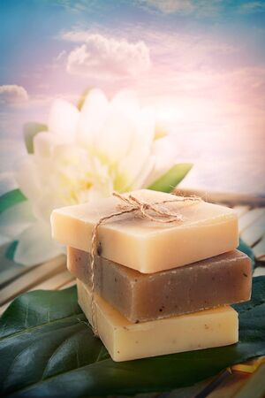 Spa setting with soaps and lotus flower  photo
