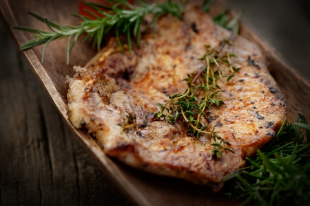 marinate: Grilled PorkSteak BBQ with herbs  Barbecue Meat Steak on wood