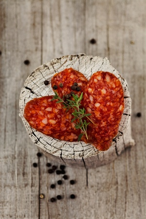 cured ham: Chorizo salami sausage on rustic background. Meat cold cuts. Stock Photo