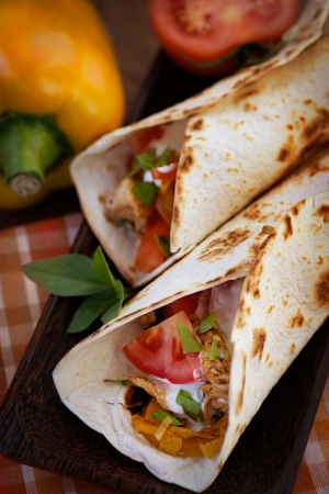 taco tortilla: Mexican food. Fresh tortilla frajita wraps with chicken and vegetables Stock Photo